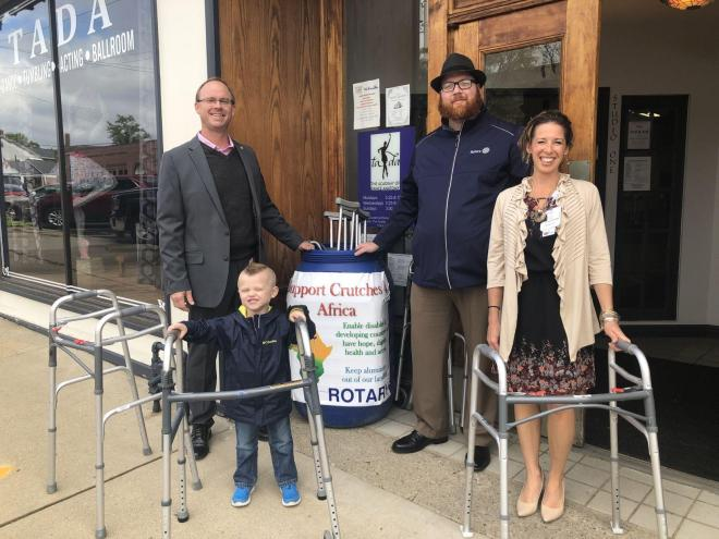 Rotarians in front of a bin where crutches and walking aides are deposited. Photo: Melissa Klaric, The Herald