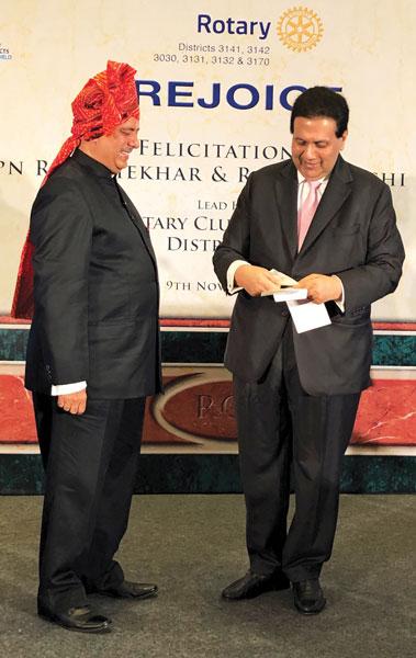 Dilip Piramal of RC Bombay presenting a cheque of $120,000 to RIPN Shekhar Mehta.