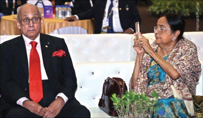 Binota Banerjee takes a picture of her husband Kalyan Banerjee.