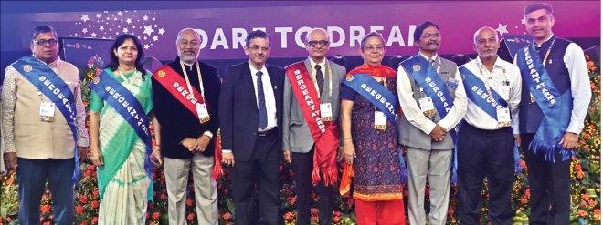 Sergeants-at-arms: (from L) PDG B Jayarajan, Mona Gyani, PDG Babu Joseph, RID Bharat Pandya, PDG J P Vyas, Neeta Vyas, DG Sivannarayana Rao, Ravi Raman and Rajith Menon.