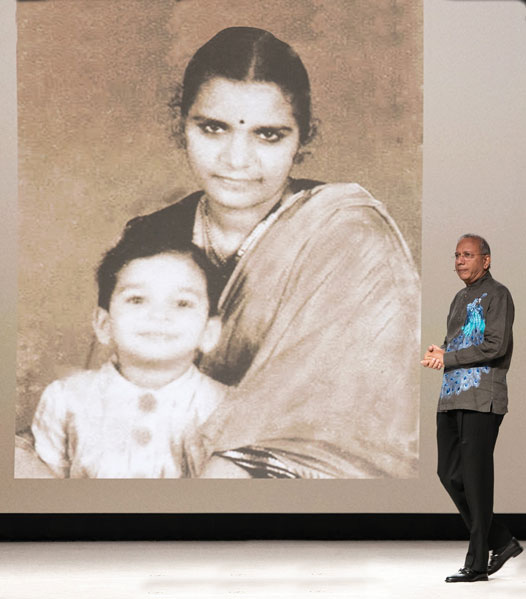 Trustee Chair-elect K R Ravindran, with a picture of him and his mother in the backdrop.
