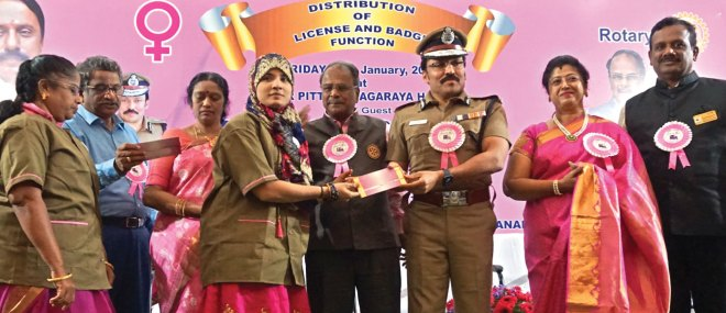ADGP M Ravi gives driving licence and badge to a beneficiary in the presence of DG G Chandramohan (centre) and his wife Manjula (third from L), Project Chair Shanthi Selvam and District Secretary Ganapathy Suresh.