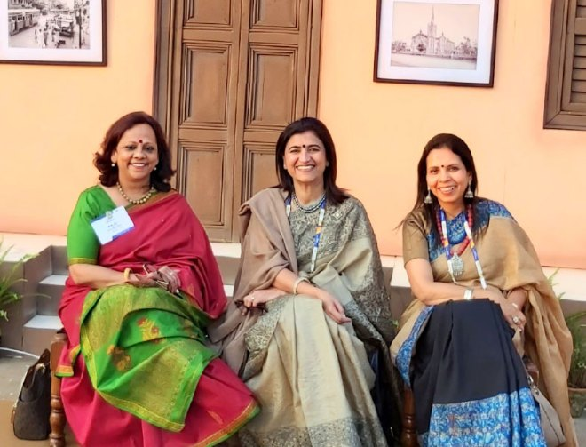 Women delegates in front of Kolkata's colonial houses reminiscent of the British-era.