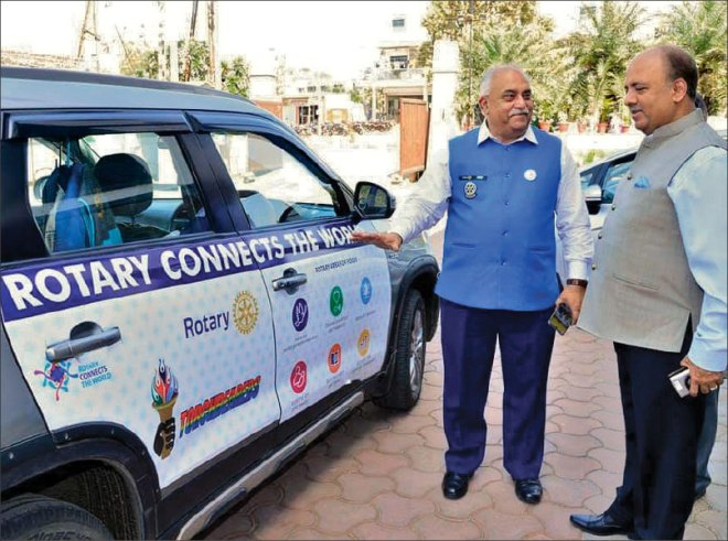 """DG Dhiran Datta, RID 3040, has adorned the exterior of his car with Rotary's six areas of focus and other flagship programmes. He is happy to share that RIPN Shekhar Mehta who visited him at Ratlam was impressed with this public image promotion and had referred to the vehicle as 'Rotary billboard'. He even made special mention of the 380 pins that adorns Datta's blazer, proof of his attending so many Rotary conferences and programmes. """"Whenever I stop over at traffic junctions people ask me about TEACH, LN-4 and all those aspects that I have painted in my car. I ask them to pull over and explain to them about Rotary and what it stands for,"""" says Datta."""