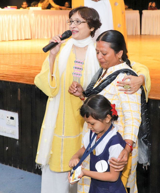 Project Udaan Chair Kalpa Rachh with a parent and her child at the Annual Day celebrations.
