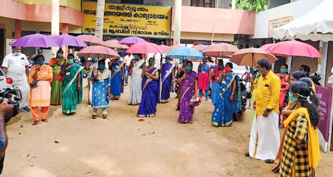 A Kerala district came out with a unique model to ensure social distancing — compulsory use of umbrellas.