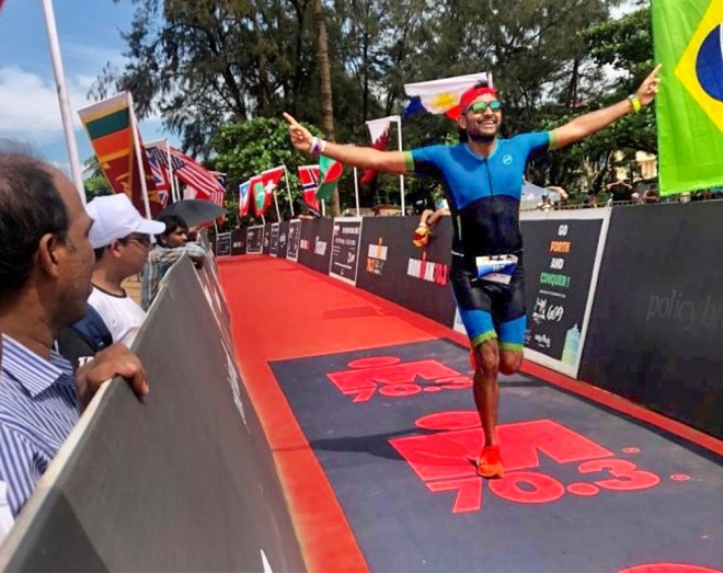 RC Kolhapur Evolve Charter President Niket Doshi at the finish line for the Ironman 70.3 title.