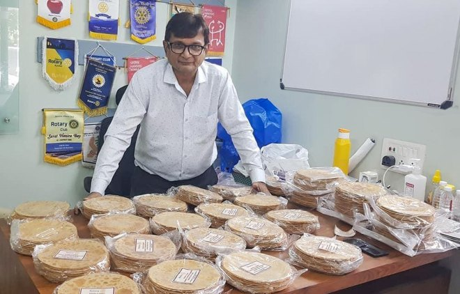 RC Surat President Nikhil Madrasi with packets of khakhra.
