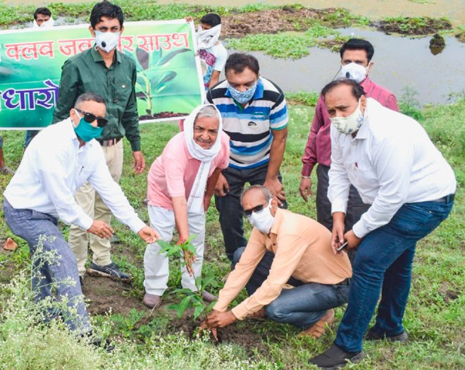 Rotarians of RC Jabalpur South, RID 3261, planting a sapling.