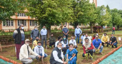 PDG Ganesh Bhat and Rotarians from RC Dharwad Central, RID 3170, planting saplings at the Rotary Ayee Garden.