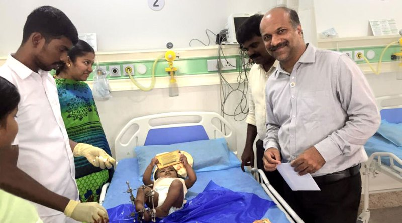 RC Coimbatore Meridian president Dr Sathishkumar at a ward where a baby is being treated for deformity.