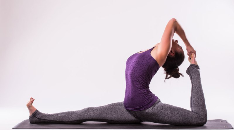 sporty-young-woman-doing-yoga-practice-isolated-white-background-concept-healthy-life-natural-balance-body-mental-development