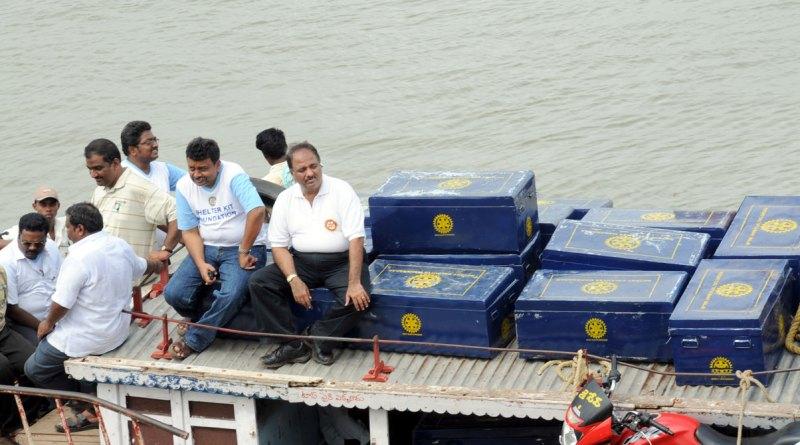 RIPE Shekhar Mehta (seated right) and PDG Ravi Vadlamani (left) reach shelter kits to disaster victims in Guntur (file photo).