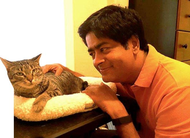 With his daughter Varsha's pet cat Vodka.