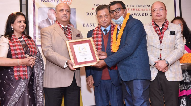 RIPE Shekhar Mehta and Rashi presenting a Rotary Journo Award to a journalist  in the presence of PDG Kiran Lal Shrestha and DG Rajib Pokhrel.