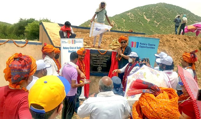The check dam being inaugurated with fanfare.