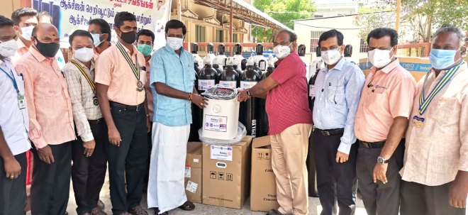 Mayiladuthurai MLA S Rajkumar (centre, left) hands over oxygen concentrators to Dr R Rajasekhar, CMO, government hospital in the presence of DG R Balaji Babu (third from R), RC Mayiladuthurai president K Durai (R) and project coordinator V Raman (fourth from L).