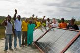 Rotarians and community members of Nan Semma on La Gonave, Haiti celebrate the successful installation of solar panels on the roof of the Kominote clinic.