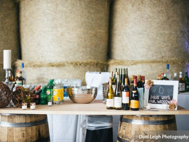 As a ROUGE client, all of our décor is available to you. Our wine barrels make a creative bar or high-top table for your cocktail hour. --- Photo by Dani Leigh Photography.