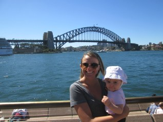 Jen and Baby Gabriella with the Sydney Bay bridge.