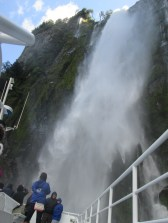 Ship inching up into the waterfall