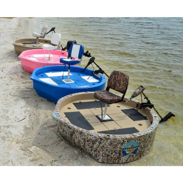A top view of four round boats at the beach