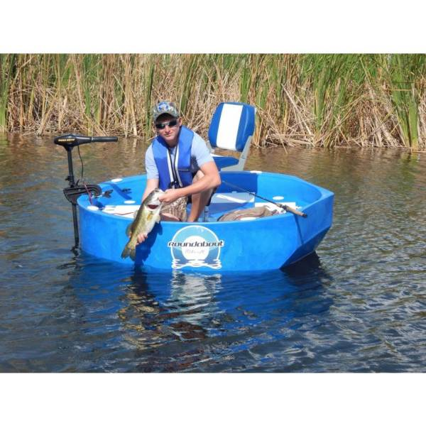 an angler in a blue round boat releasing a bass he just caught