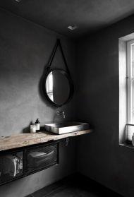 Dark moody bathroom designs that impress (12)