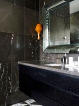 Dark moody bathroom designs that impress (15)