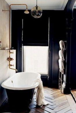 Dark moody bathroom designs that impress (17)