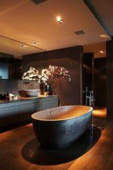 Dark moody bathroom designs that impress (2)