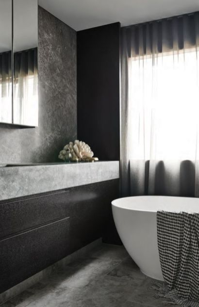 Dark moody bathroom designs that impress (20)