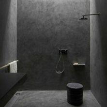Dark moody bathroom designs that impress (22)