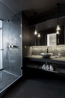 Dark moody bathroom designs that impress (24)