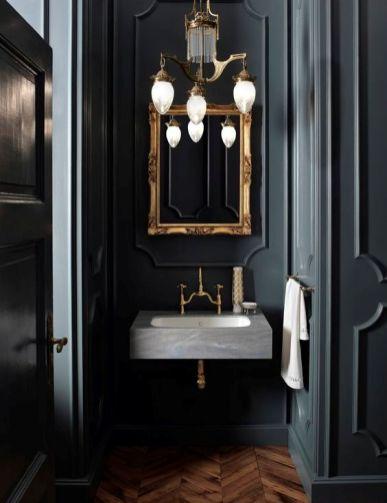 Dark moody bathroom designs that impress (25)