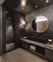 Dark moody bathroom designs that impress (8)