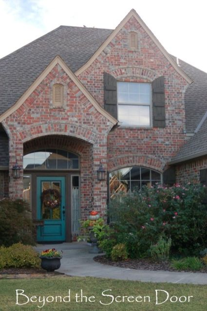 Exterior paint color ideas with red brick 23