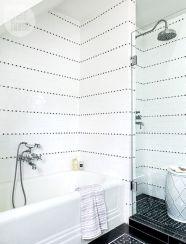 Stylish white subway tile bathroom 10