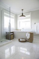 Stylish white subway tile bathroom 27