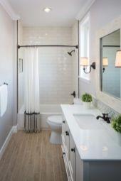 Stylish white subway tile bathroom 34