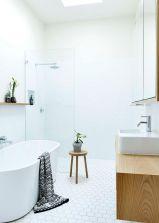 Stylish white subway tile bathroom 36
