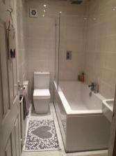 Stylish white subway tile bathroom 37