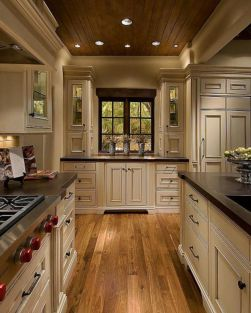 Amazing cream and dark wood kitchens ideas 23