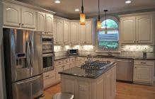 Amazing cream and dark wood kitchens ideas 39