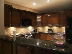 Inspiring black quartz kitchen countertops ideas 21