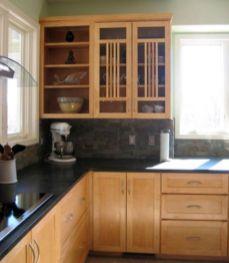 Inspiring black quartz kitchen countertops ideas 23