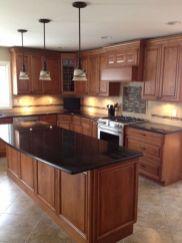 Inspiring black quartz kitchen countertops ideas 50