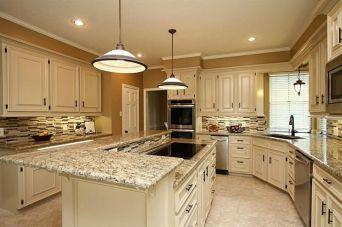 Modern cream painted kitchen cabinets ideas 11