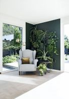 Stylish dark green walls in living room design ideas 33