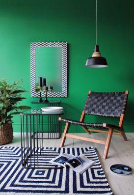 Stylish dark green walls in living room design ideas 35
